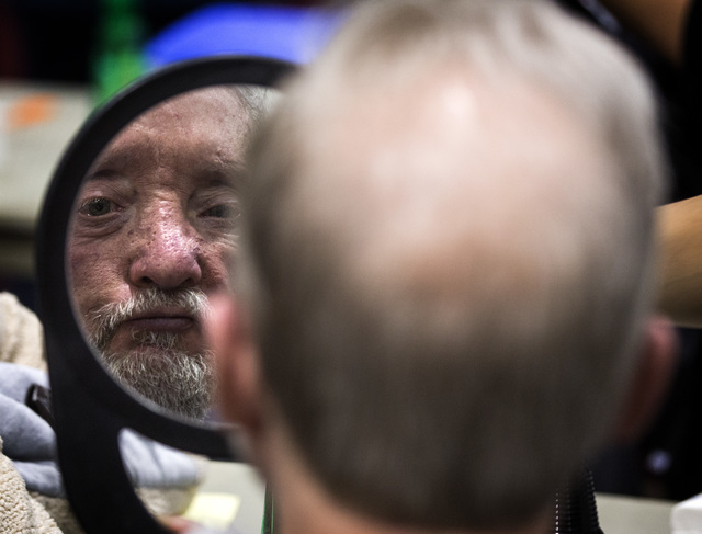 Wade Fisher looks in the mirror after getting a hair cut during the annual Project Homeless Connect at Cashman Center, 850 Las Vegas Boulevard North, on Wednesday, November 19,2014.Thousands of pe ...