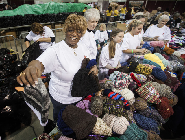 Yvonne Martin hands out handmade knit hats during the annual Project Homeless Connect at Cashman Center, 850 Las Vegas Boulevard North, on Wednesday, November 19,2014. A group of local Methodist c ...