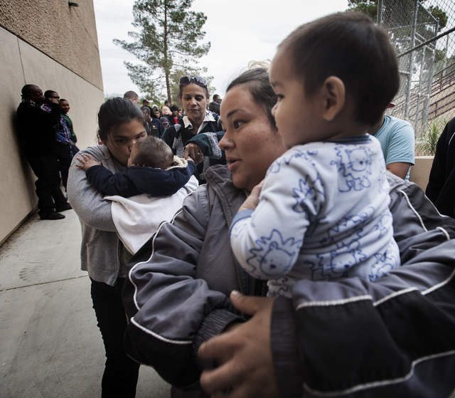 Daniela Gutierrez,center, holds her son Francisco Gutierrez, turning 1-year-old on Saturday,  while standing in line at  the annual Project Homeless Connect at Cashman Center, 850 Las Vegas Boulev ...