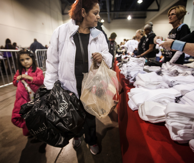 Sehida Maldonado, right, and her daughter Donna Venegas, 4, carries bags full of free clothes during the annual Project Homeless Connect at Cashman Center, 850 Las Vegas Boulevard North, on Wednes ...