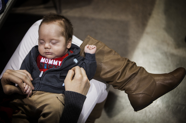 Lacy Cain, 22, holds her  son Romeo Campbell, two months, during the annual Project Homeless Connect at Cashman Center, 850 Las Vegas Boulevard North, on Wednesday, November 19,2014. Thousands of  ...