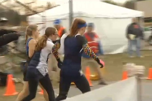 Two Minnesota high school runners have been disqualified in the state girls cross country meet for helping an opponent who fell. (Screengrab/KEYC-TV)