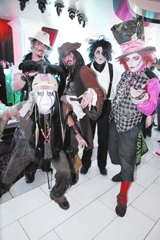 One of the cleverest Halloween costume ideas paid off for five men on Saturday, Nov. 1, 2014, at the Palms' ghostbar day club. The quintet split the $5,000 first-place winnings by dressing as fi ...