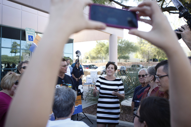 Bridget Lavington rallies volunteers with Nevadans for Background Checks during a press conference outside of the Clark County Election Center in North Las Vegas before submitting 246,674 signatur ...