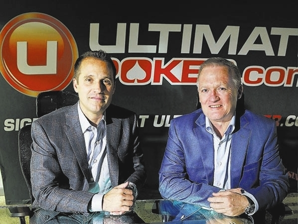 Ultimate Gaming chairman Tom Breitling, left, and CEO Tobin Prior sit for a photo at their company headquarters, Monday, April 29, 2013, in Las Vegas. (AP Photo/Julie Jacobson)