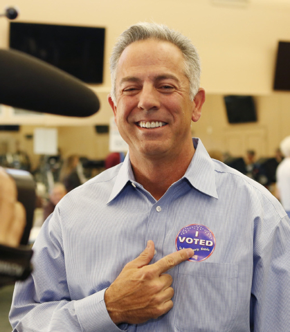 """Clark County sheriff candidate Joe Lombardo addresses the media as he points to his """"I Voted"""" sticker after casting his vote Tuesday, Nov. 4, 2014, at Las Ventanas Community Center, 10401 W. Charl ..."""