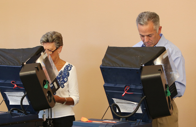 Sheriff candidate Joe Lombardo, right, casts his vote at Las Ventanas Community Center on 10401 W Charleston Blvd. near Charleston and Town Center Tuesday, Nov. 4, 2014. (Bizuayehu Tesfaye/Las Veg ...