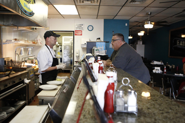 Robert Polk, left, owner and chef at at Kailyn's Diner, speaks with customer David Kaempfer during breakfast service at his restaurant, 3430 E. Tropicana Ave., suite 6, Sunday, Nov. 9, 2014. (Erik ...