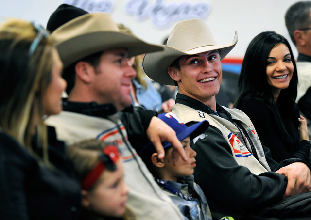 Rodeo champion Trevor Brazile, left, and Tuff Cooper sit in the classroom at the Richard Petty Driving Experience before they take to the track at the Las Vegas Motor Speedway on Sunday, Nov. 30,  ...