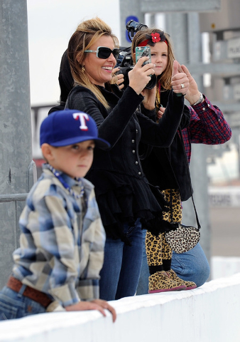Rodeo champion Trevor Brazile's family from left, son Treston, wife Shada and daughter Style, watch Brazile drive around the Las Vegas Motor Speedway on Sunday, Nov. 30, 2014. Brazile and fellow r ...