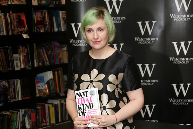 """Actress Lena Dunham holds her memoir, """"Not That Kind Of Girl,"""" ahead of a book signing at Waterstones bookshop in Piccadilly in central London, Oct. 29, 2014. (Joel Ryan/Invision/AP, File)"""