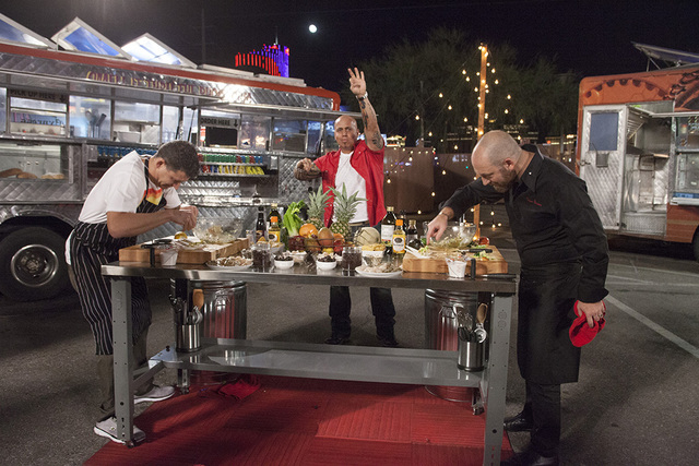 "Co-host Vic ""Vegas"" Moea looks on as local chefs compete on FYI's ""Late Nite Chef Fight."" (Richard Knapp/FYI)"