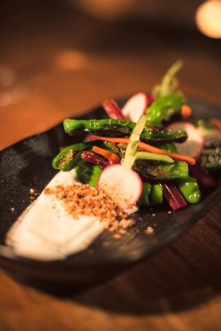 Shishito peppers with pickled swiss chard stems and creamy tofu dressing. (Courtesy)