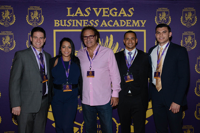 From left, Las Vegas Business Academy chairman and founder Rino Armeni, scholarship recipients Matthew Sheahan, Tasha Schwikert, Daven Cameron and Keivan Roebuck pause a moment during Rockin' on ...