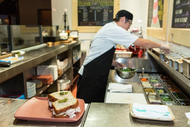 Chef Kee Yang makes a sandwich at Made LV restaurant in Tivoli Village at Rampart Boulevard and Alta Drive in Las Vegas is shown Saturday, Nov. 1, 2014. (Donavon Lockett/Las Vegas Review-Journal)