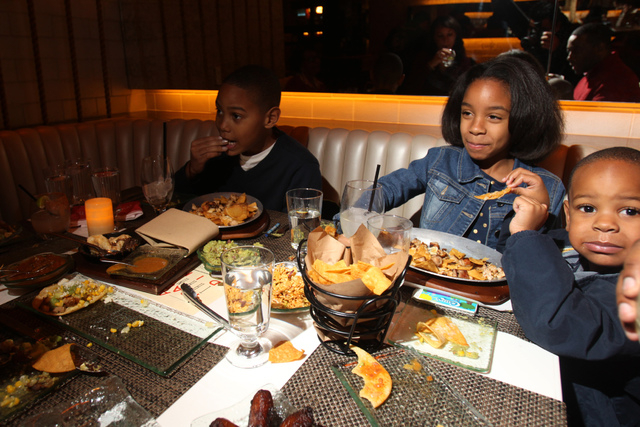 Bryce Jackson, 10, from left, his sister Bailey, 7, and brother Bryce, 3, dine with their parents at Mercadito restaurant inside Red Rock Resort in Las Vegas Saturday, Nov. 22, 2014. (Erik Verduzc ...