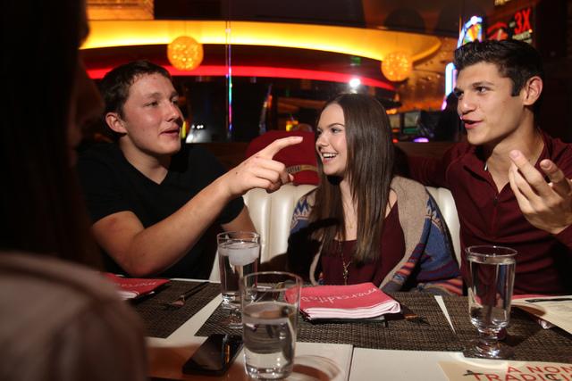 Ethan Fridman, from left, with his friends Eden Miller, and Antonio Gutierrez, dine at Mercadito restaurant inside Red Rock Resort in Las Vegas Saturday, Nov. 22, 2014. (Erik Verduzco/Las Vegas Re ...