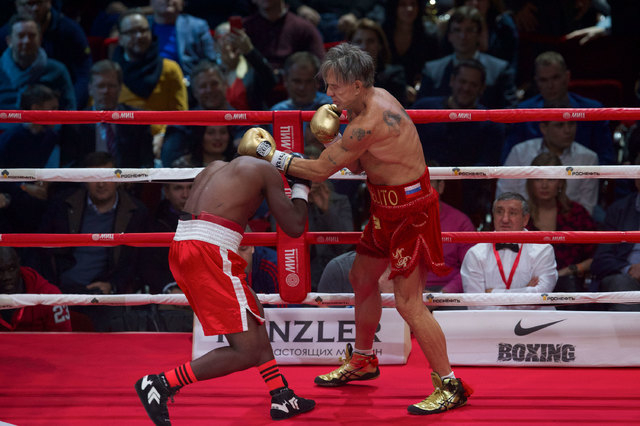 Mickey Rourke, right, punches his opponent, Elliot Seymour of the United States, during their professional boxing match, at the Luzhniki Stadium in Moscow, Friday, Nov, 28, 2014. The Hollywood act ...