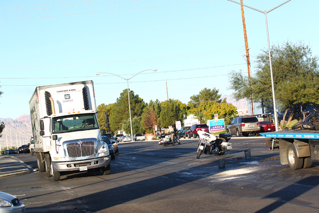 Traffic is routed to one lane on eastbound Flamingo Road near Lindell Road as Las Vegas police respond to a three-vehicle crash, which involved a motorcycle whose driver fled the scene in Las Vega ...