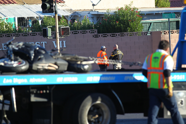 Las Vegas police respond to a three-vehicle crash at Flamingo and Lindell roads, which involved a motorcycle whose driver fled the scene and two other vehicles, in Las Vegas on Monday morning, Nov ...