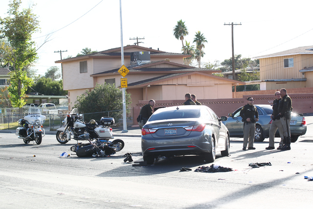 Las Vegas police respond to a crash involving a moped and a car near Harmon Avenue and Pancho Villa Drive, near Nellis Boulevard, in Las Vegas on Wednesday, Nov. 19, 2014. The motorcyclist, who su ...