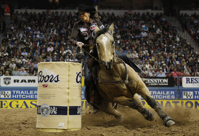Lisa Lockhart earns a third place in barrel racing during round 7 of the Wrangler National Finals Rodeo at the Thomas & Mack Center in Las Vegas on Dec. 12, 2012. (Jason Bean/Las Vegas Review-Journal)