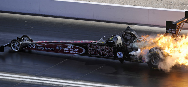 The engine on the Top Fuel dragster driven by Larry Dixon explodes during the first round of eliminations during the Toyota Nationals at The Strip at Las Vegas Motor Speedway in Las Vegas Sunday,  ...