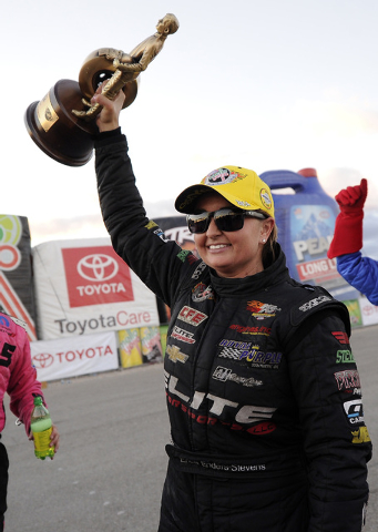 NHRA Pro Stock driver Erica Enders-Stevens hoists the Wally trophy after winning the Toyota Nationals at The Strip at Las Vegas Motor Speedway in Las Vegas Sunday, November 2, 2014.(Josh Holmberg/ ...