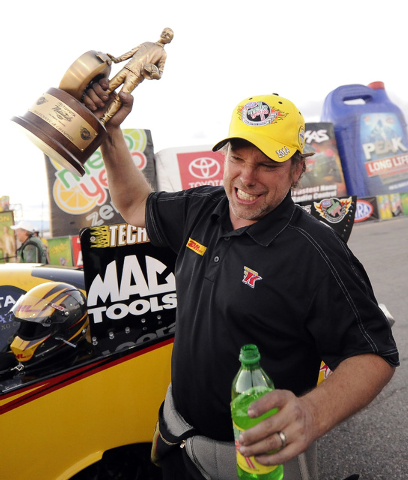 NHRA Funny Car driver Del Worsham hoists the Wally trophy after winning the Toyota Nationals at The Strip at Las Vegas Motor Speedway in Las Vegas Sunday, November 2, 2014.(Josh Holmberg/Las Vegas ...