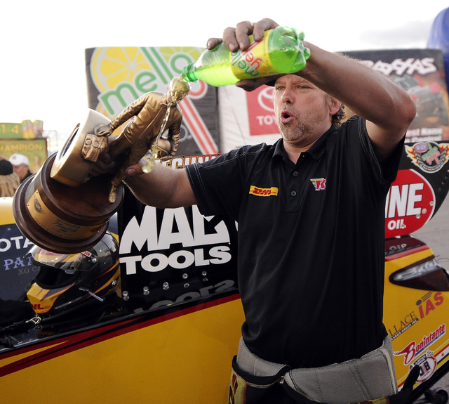 NHRA Funny Car driver Del Worsham pours soda onto the Wally trophy after winning the Toyota Nationals at The Strip at Las Vegas Motor Speedway in Las Vegas Sunday, November 2, 2014.(Josh Holmberg/ ...
