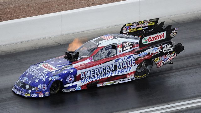 NHRA Funny Car driver John Force makes a pass of 319.45 miles per hour at 4.069 elapsed time during the second round of eliminations during the Toyota Nationals at The Strip at Las Vegas Motor Spe ...