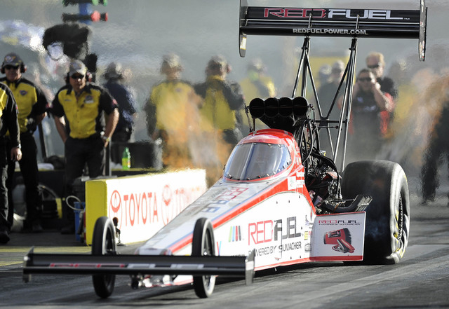 NHRA Top Fuel driver and race winner Spencer Massey races to an elapsed time of of 3.775 seconds at 325.22 miles per hour during the third round of eliminations during the Toyota Nationals at The  ...