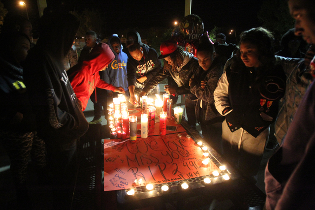 Friends of Roland Pleasant, the 18-year-old man shot and killed Tuesday night in North Las Vegas, attend a vigil for him at a park at East Azure Avenue and Terrasol Street near North Pecos Road in ...