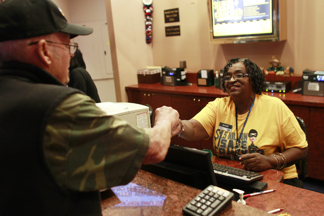 Mayme Grant helps James Keith while working at the Texas Station rewards counter Thursday, Nov. 6, 2014. (Sam Morris/Las Vegas Review-Journal)