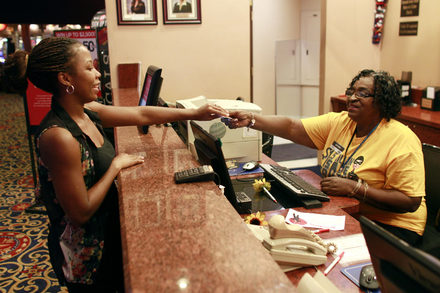 Mayme Grant helps Kittani Russell-Boozer while working at the Texas Station rewards counter Thursday, Nov. 6, 2014. (Sam Morris/Las Vegas Review-Journal)
