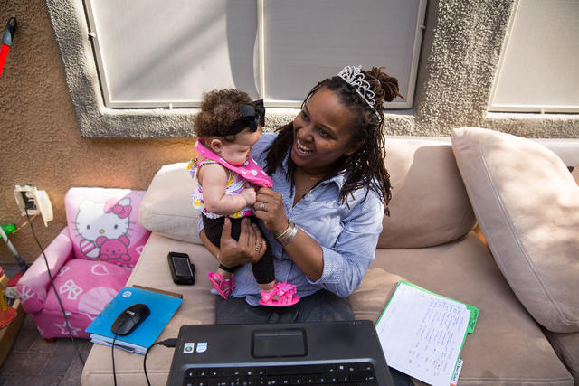 LaTeefa Starks holds her 3-month-old niece, Aaliyah Starks, at her family's North Las Vegas home Thursday, Nov. 13, 2014. Starks is a graduate from HOPE for Prisoners, a Las Vegas nonprofit that h ...