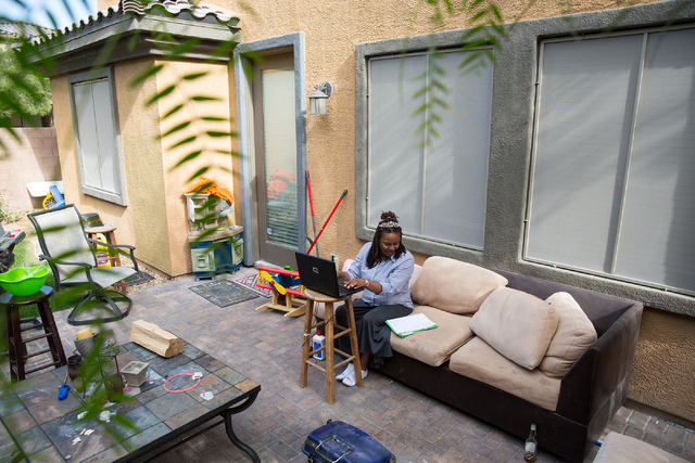 LaTeefa Starks works outside at her family's North Las Vegas home Thursday, Nov. 13, 2014. Starks is a graduate from HOPE for Prisoners, a Las Vegas nonprofit that helps offenders exiting the syst ...