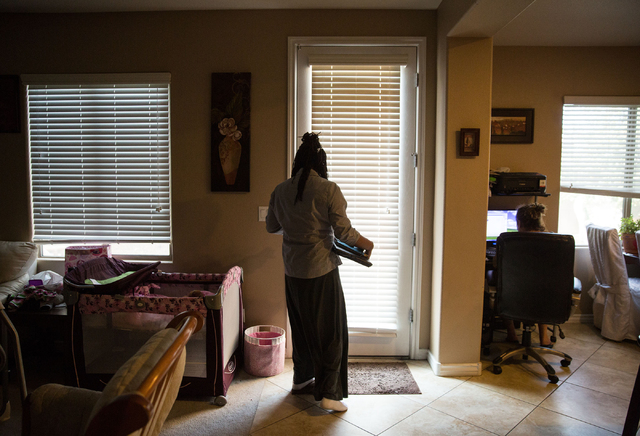 LaTeefa Starks takes her computer work outside at her family's North Las Vegas home Thursday, Nov. 13, 2014. Starks is a graduate from HOPE for Prisoners, a Las Vegas nonprofit that helps offender ...