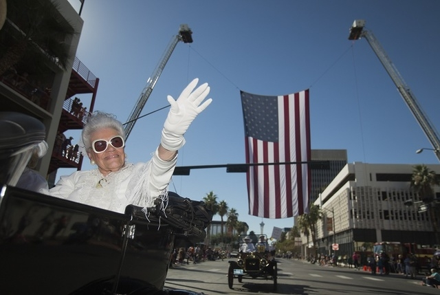 Joan Doubrava waves while participating in the  Nevada Day Parade on Fourth Street in downtown Las Vegas on Friday, Oct. 31. Thousands lined the street to celebrate Nevada's  Sesquicentennial. (Je ...