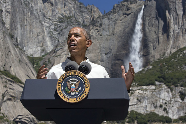 President Barack Obama speaks by the Sentinel Bridge in the Yosemite Valley in front of Yosemite Falls at Yosemite National Park, Calif., on Saturday, June 18, 2016. (Jacquelyn Martin/The Associat ...