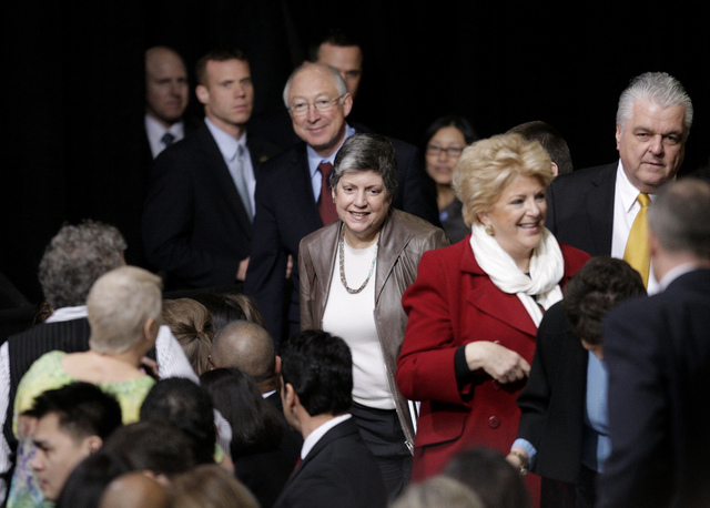Janet Napolitano, secretary of homeland security, center, arrives at President Barack Obama's speech about immigration reform at Del Sol High School in Las Vegas on Tuesday, Jan. 29, 2013. (Jessic ...