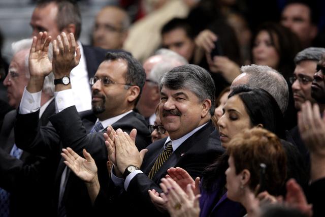 Labor leader Richard Trumka, center, applauds during President Barack Obama's speech about immigration reform at Del Sol High School in Las Vegas on Tuesday, Jan. 29, 2013. (Jessica Ebelhar/Las Ve ...