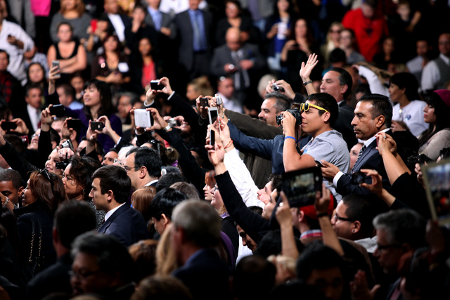 The crowd tries to catch photos of President Barack Obama after he spoke about immigration reform at Del Sol High School in Las Vegas on Tuesday, Jan. 29, 2013. (Jessica Ebelhar/Las Vegas Review-J ...