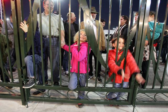 Molly Schlager, 6, and Aiden Powell, 5, both of Henderson, wait for the gate to open at Opportunity Village's Magical Forest in Las Vegas on Friday, Nov. 28, 2014. Opportunity Village commemorates ...