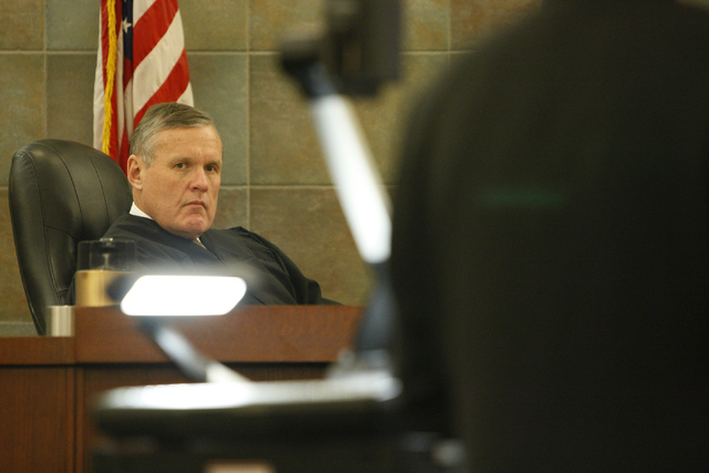 """District Court Judge David Barker listens to the prosecution during the murder trial for Markiece Palmer, accused of fatally beating his stepson Roderick """"RJ"""" Arrington, at the Regional  ..."""