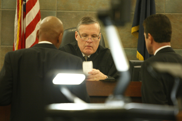 """District Court Judge David Barker, center, reads a question from a jury member during the murder trial for Markiece Palmer, accused of fatally beating his stepson Roderick """"RJ"""" Arrington ..."""
