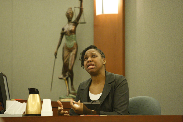 """Dina Palmer, the mother of Roderick """"RJ"""" Arrington, 7, sits on the witness stand during the murder trial for her husband Markiece Palmer, accused of fatally beating his stepson RJ, at th ..."""