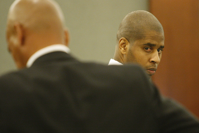 """Markiece Palmer, accused of fatally beating his stepson Roderick """"RJ"""" Arrington, 7, stands during his murder trial at the Regional Justice Center on Wednesday, Nov.19, 2014. Palmer faces ..."""