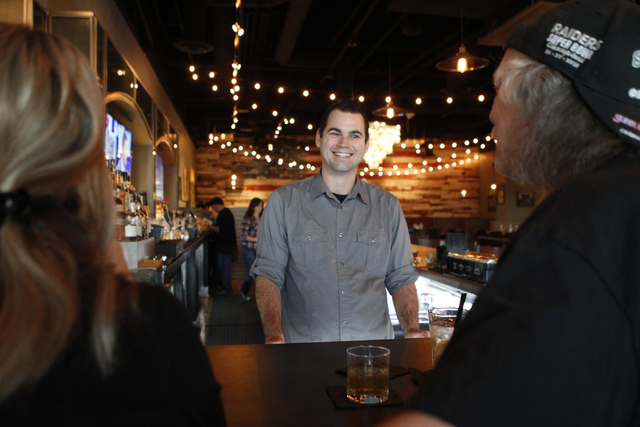 Director of beverage Christian Hall, speaks with customers during dinner service at Pot Liquor C.A.S. at Town Square in Las Vegas Saturday, Nov. 15, 2014. (Erik Verduzco/Las Vegas Review-Journal)