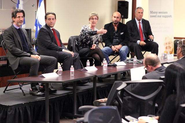 Panelists, from left, Dr. Brian Lawenda, attorney Carlos Blumberg, Clark County Commissioner Chris Giunchigliani, attorney Edward M. Bernstein and Clark County District Attorney Steve Wolfson talk ...